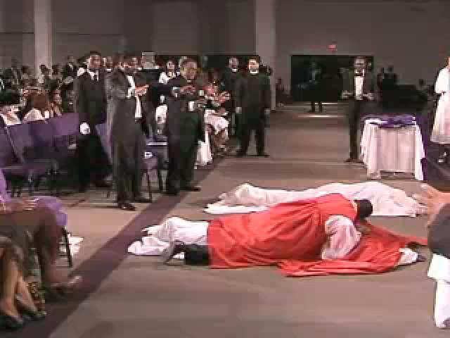 bishop laying on bishop